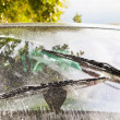 Car wipers wash windshield — Stock Photo