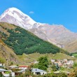 Stock Photo: Village Stepantsmindand Mount Kazbek in Georgia
