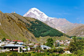 Town Kazbegi and Mount Kazbek in Georgia — Stock Photo