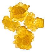 Pieces of yellow crystalline sugar — Stock Photo
