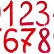 Stock Photo: Arabic numerals hand written by red paint