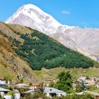 Stock Photo: Village Kazbegi and Mount Kazbek in Georgia