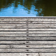 Wood flooring on shore lake — Stock Photo