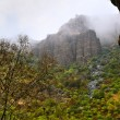 Cliffs in fog cloud in rain in Armenia — Stock Photo #33152753