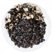 Stock Photo: Top view of sunflower seeds and husks on plate