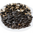 Stock Photo: Sunflower seeds and husks on plate