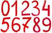 Arabic numerals hand written by red paint — Stock Photo