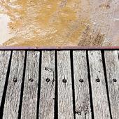 Footbridge over slushy rural road — Stock Photo