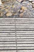 Wooden bridge over mountain river — Stock Photo