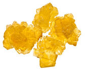 Pieces of yellow crystalline caramel sugar — Stock Photo