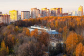 Urban residential district in pink autumn sunset — Stock Photo