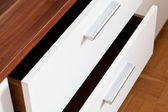 Open drawers of linen cupboard — Stock Photo