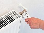 Adjusting of home temperature — Stock Photo