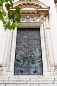 Old bronze doors of church — Stock Photo