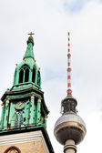 Fernsehturm tv tower and st. marys church — Stock Photo