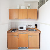 Simple kitchen with furniture set — Stock Photo