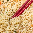 Eating instant noodles by red chopsticks — Stock Photo