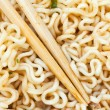 Eating instant ramen by wooden chopsticks — Stock Photo