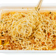 Eating of instant noodles from lunch box — Stock Photo