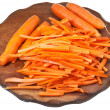 Raw cleaned and strips sliced carrots on board — Stock Photo
