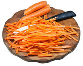 Sliced carrot and ceramic knife on cutting board — Stock Photo