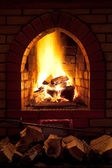 Fire in home fireplace — Stock Photo
