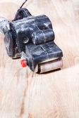 Finishing ashwood furniture board by belt sander — Stock Photo