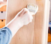 Lacquering by clear varnish of beach wooden board — Stock Photo