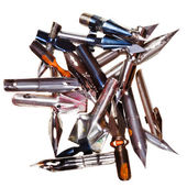 Heap of used metal nibs — Stock Photo