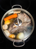Simmer of beef broth with seasoning vegetables — Stock Photo