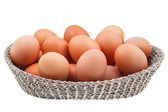 Twenty fresh chicken eggs in wicker basket — Stockfoto