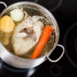 Boiling of chicken soup with seasoning vegetables — Stock Photo