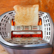 Prepared toast on hot metal toaster — Stock Photo