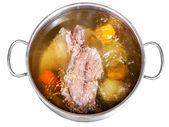 Open steel pan with cooking beef broth — Stock Photo