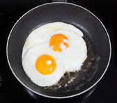 Top view of two fried eggs in frying pan — Stock Photo