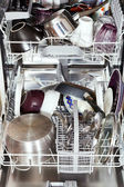 Dirty cookware in open dishwasher — Stock Photo