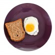 Top view of fried egg and toasted rye bread — Stock Photo #36103213