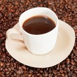 Stock Photo: Cup of coffee and roasted beans