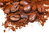 Ground and roasted coffee beans — Stock Photo