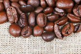 Roasted coffee beans on bagging — Stock Photo