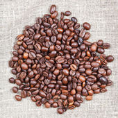 Handful of roasted coffee beans — Stock Photo