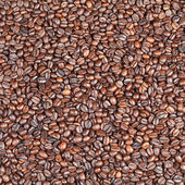 Many dark roasted coffee beans — Stock Photo