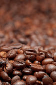 Dark roasted coffee beans background — Stock Photo