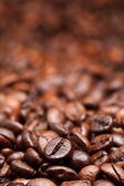Red roasted coffee beans background — Stock Photo