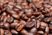 Surface with roasted coffee beans — Stock Photo