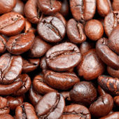Red roasted coffee beans close up — Stock Photo