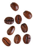 Several falling roasted coffee beans — Stock Photo