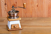 Coffee mill on wooden table — Stock Photo