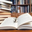 Open books on wooden table — Stock Photo #37712231
