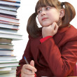 Schoolgirl, schoolwork and stack of books — Stock Photo #37712327